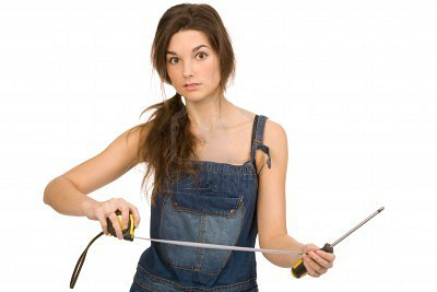 4882560-young-woman-with-tools-on-a-white-background2