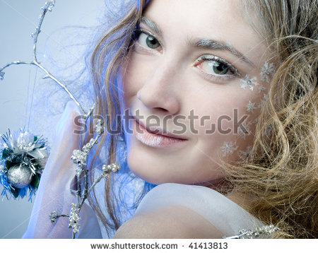 stock-photo-winter-girl-with-beautiful-make-up-on-blue-background-41413813