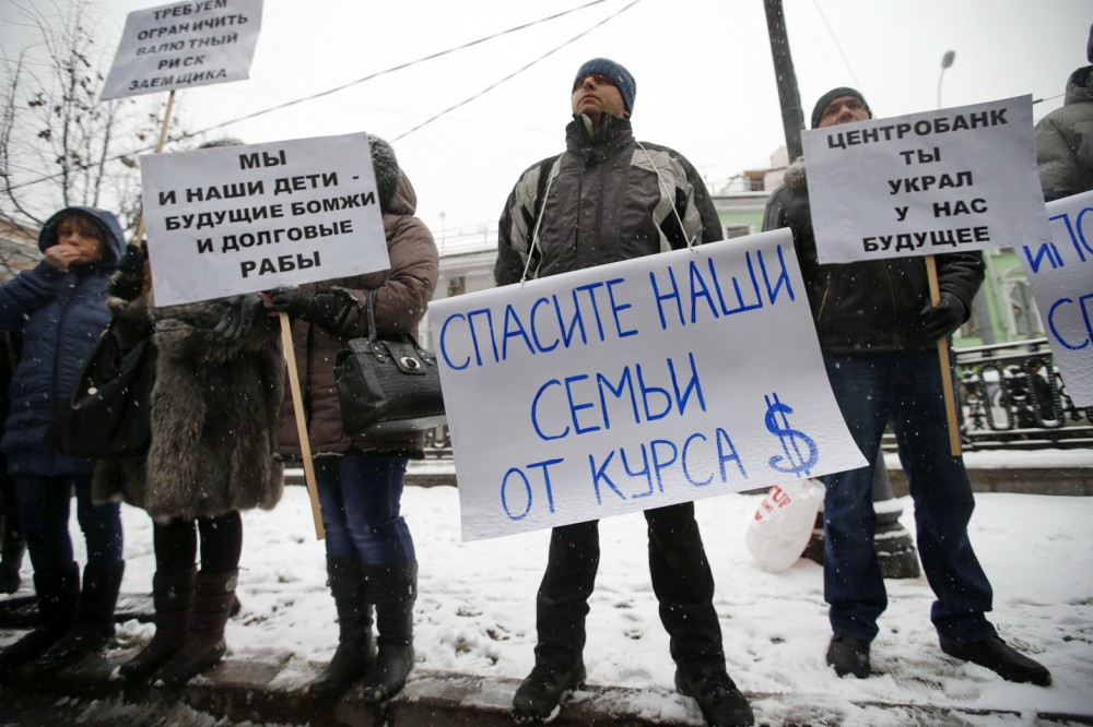 protesters-hold-placards-during-picket-central-moscow-december-12-2014-according-local-media