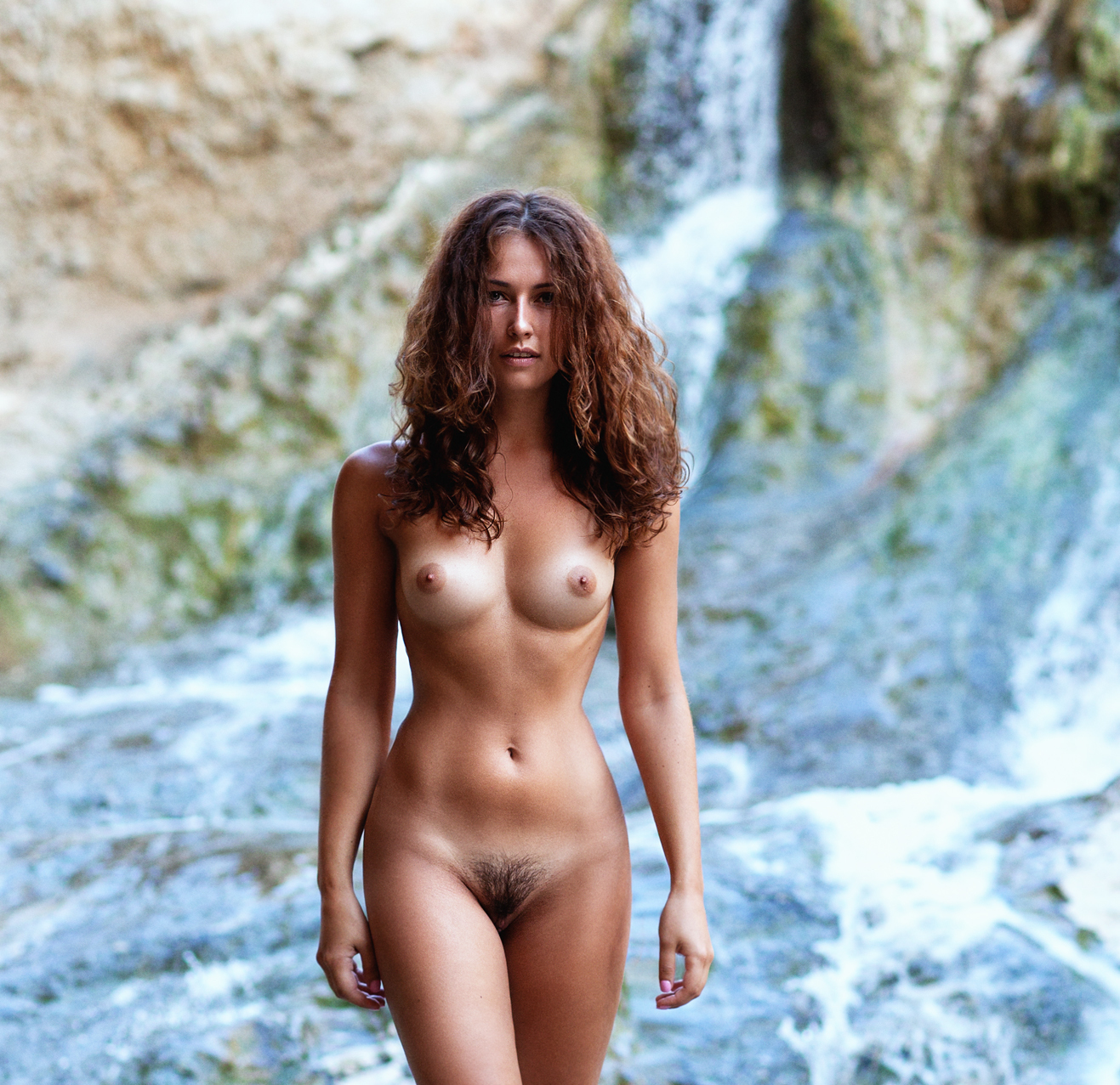 Beautiful Nude Model With A Sexy Flat Tummy And Slick Pussy