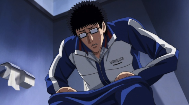 Inui sitting on the toilet, looking distressed