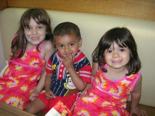 Maya, Akash and Nadia waiting for their Happy Meals!
