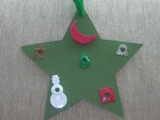 The other side of Maya's green star ornament
