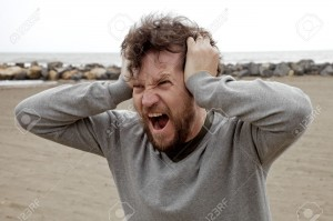 30467629-Angry-crazy-furious-man-shouting-holding-head-with-hands-Stock-Photo