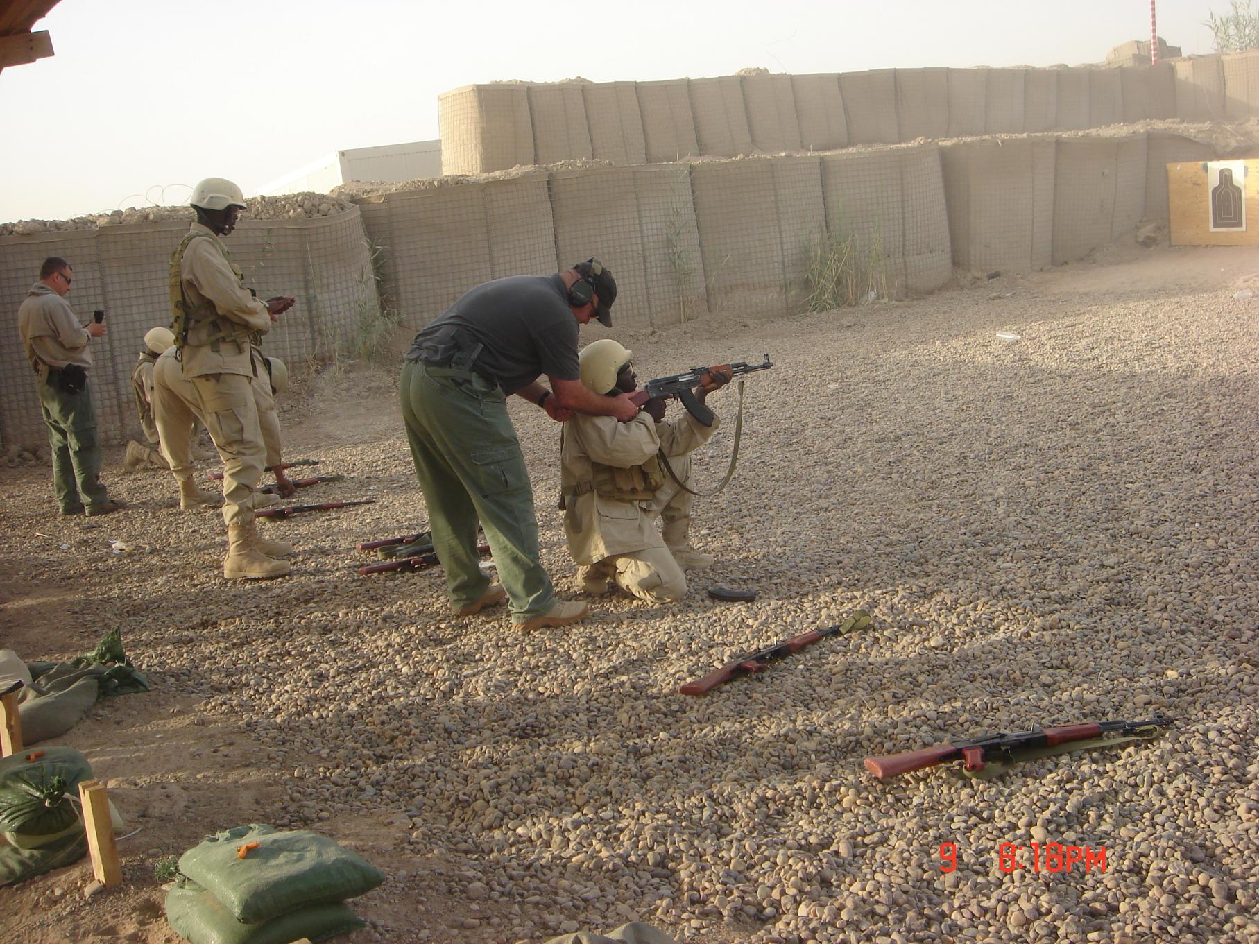 Oleg,John and Ugandans on thwe range.Kneel position
