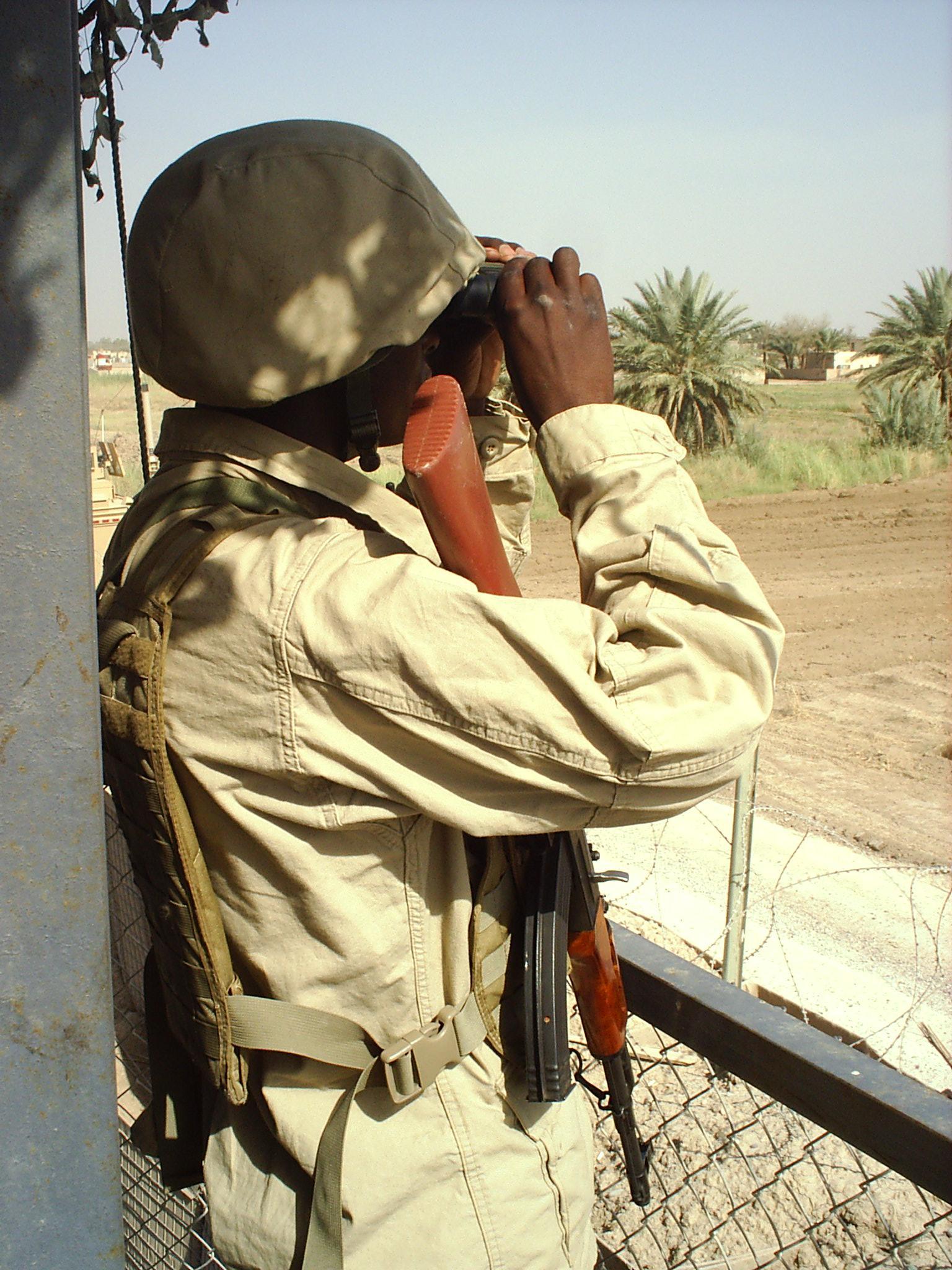 Ugandan guard on tower
