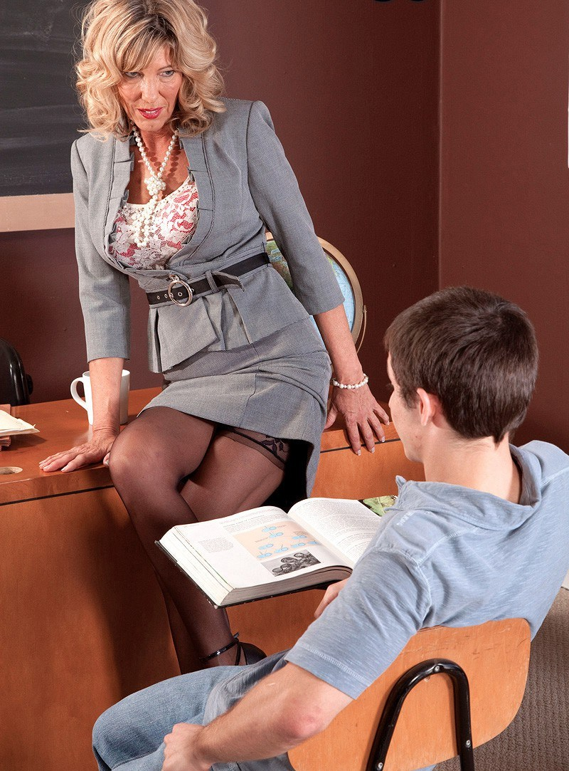 Happy male mature teacher looking