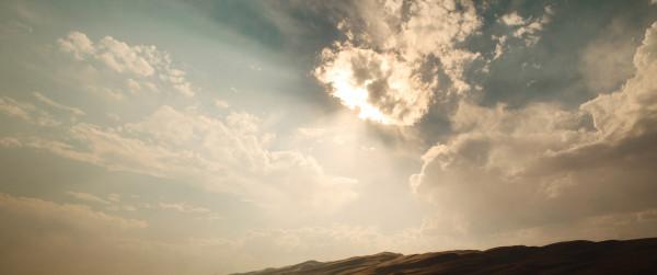 sun-behind-cloud