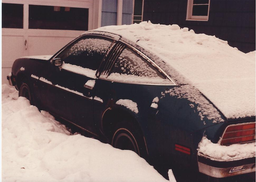Pontiac Sunbird full of snow