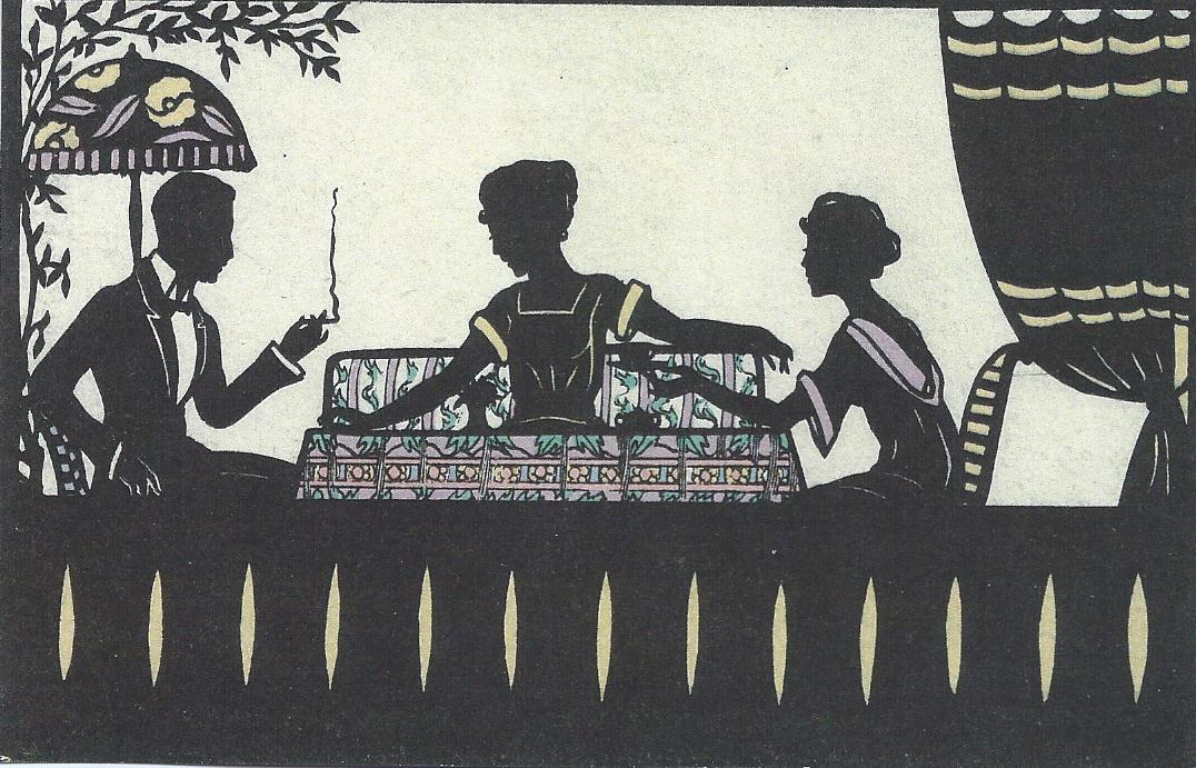 two women and a man smoking at the table