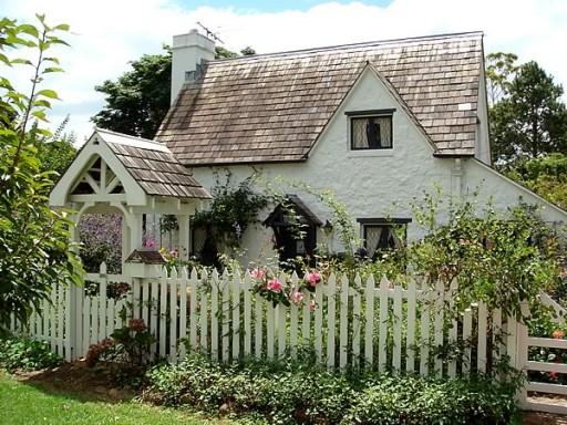1950s white pickett fence house