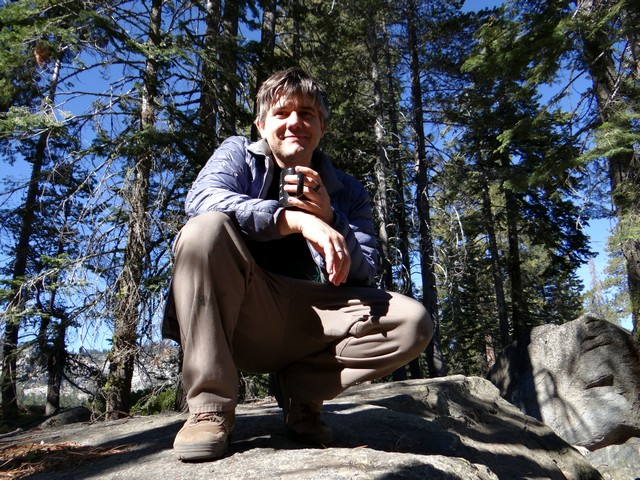 Barry drinking coffee on a boulder at Silver Lake Campground, September 2016
