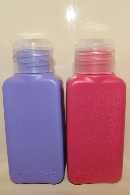 Barry's shampoo and conditioner bottles