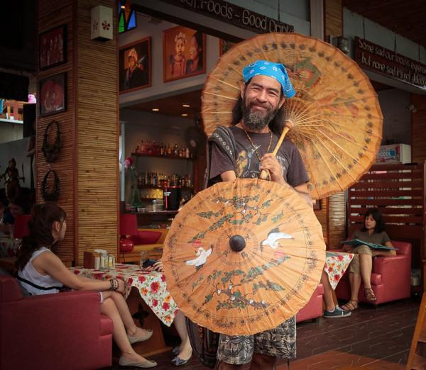 Продавец зонтиков