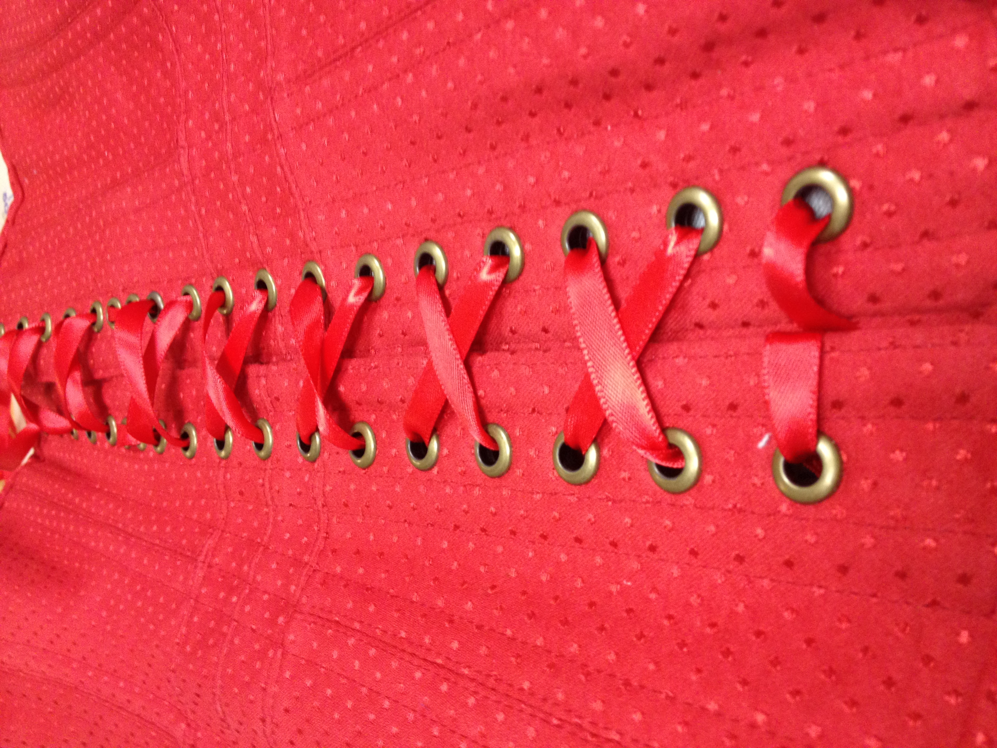 Grommet and lacing detail of Heart Truth corset