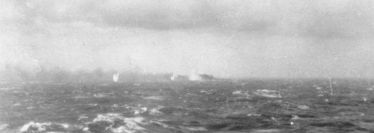 Battleship_Bismarck_burning_and_sinking_1941