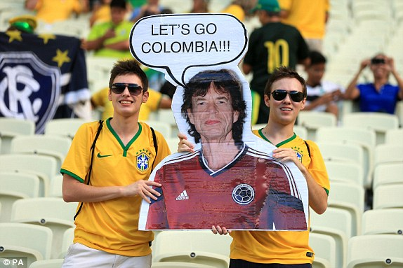0 1404499072083_lc_galleryImage_Brazil_fans_hold_up_a_cut