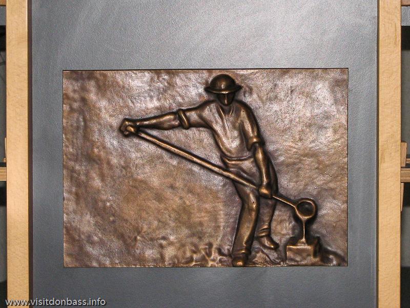 Эмблема с изображением сталевара в Люксембурге