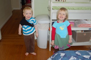 Neil and Zinnia try on the baby clothes.