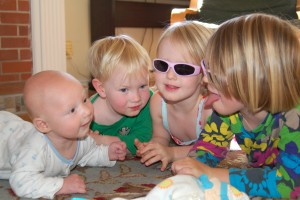 All four kids holding up their heads
