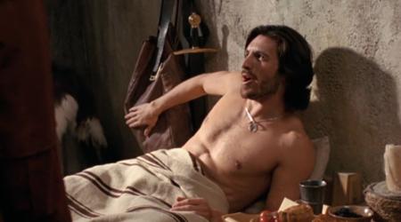 Yet another half-naked hottie in Merlin's bed.