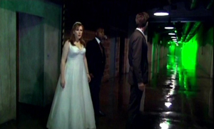 Donna and company in a corridor