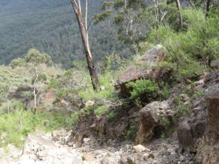 Sliding down a rocky gully