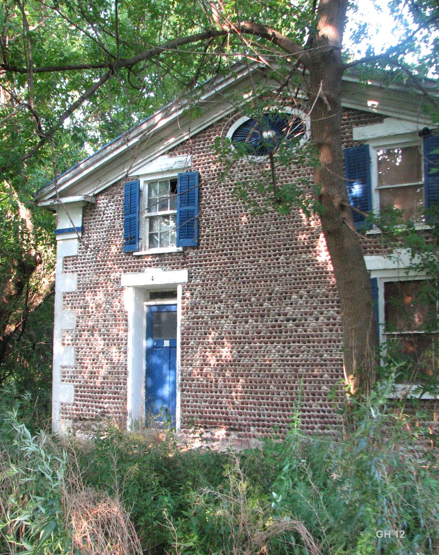 Abandoned cobblestone gas station rural ruin for Cobblestone shutters