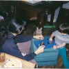 Me, when I had very long hair, our cat tiger, and my brother richie. Playing with some type of magnetic toy on Christmas.
