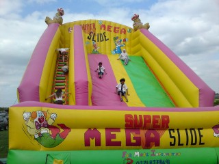 The boys playing at the mega-slide