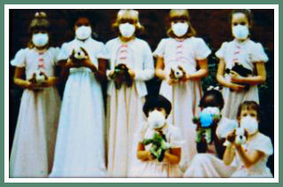 Heather and her court wearing masks in 1980
