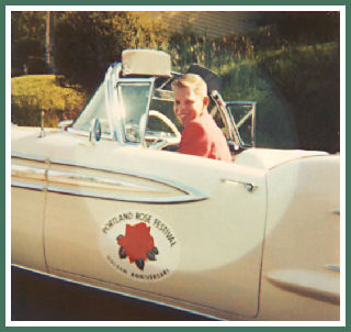 Wayne driving a 1958 Oldsmobile convertible