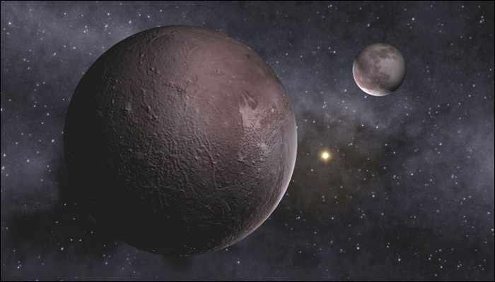 pluto demoted no longer a planet in highly controversial - 700×400