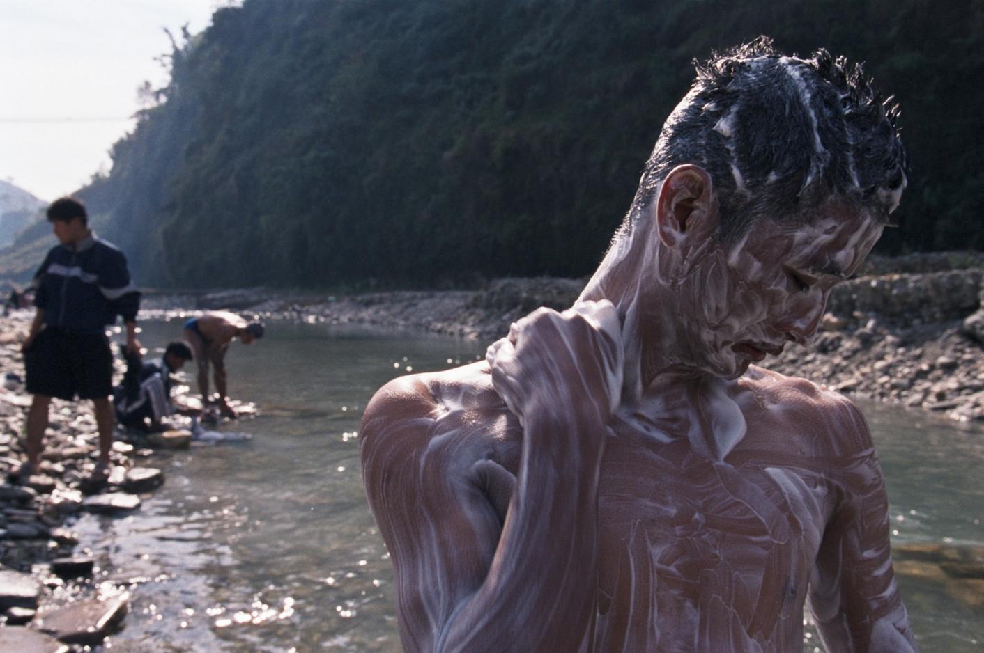 Washing_in_river__Pokara__Nepal