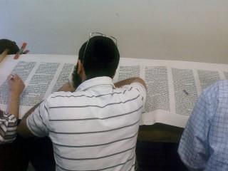 A Torah scroll being restored