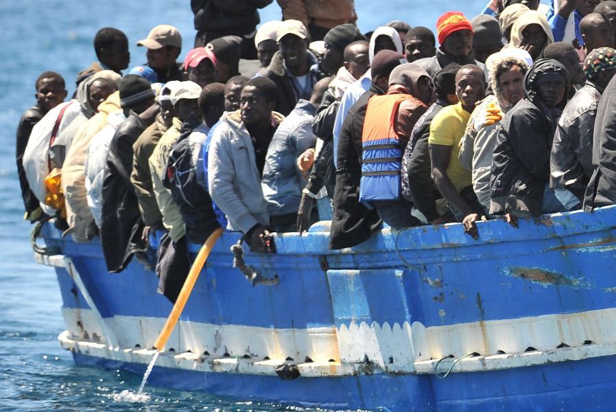 мигранты главн