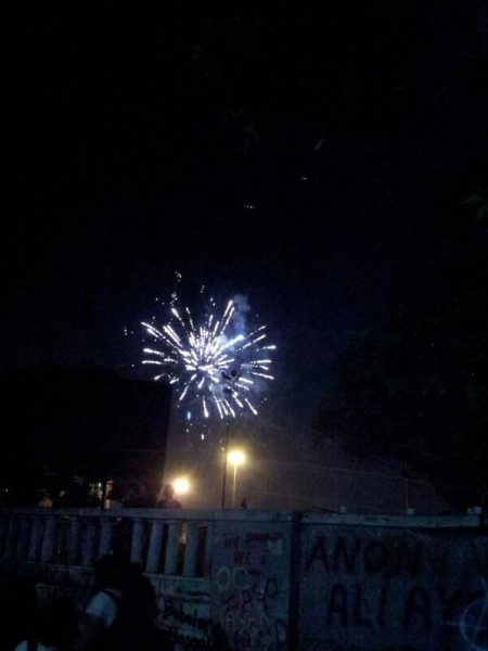 People are throwing firework to avoid helicopters throwing gas bombs