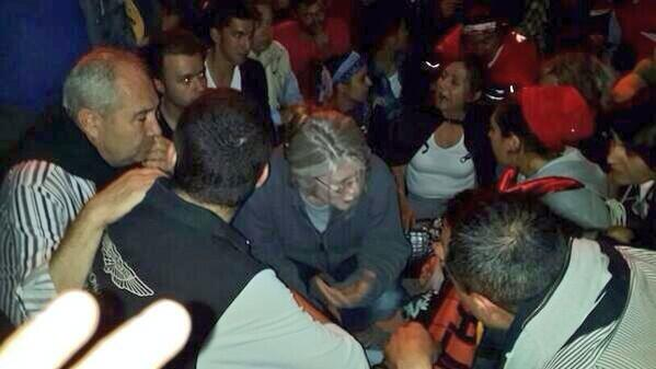 CHP PM Emine Ülker Tarhan, sitting in front of a TOMA to stop it on Kennedy St Ankara
