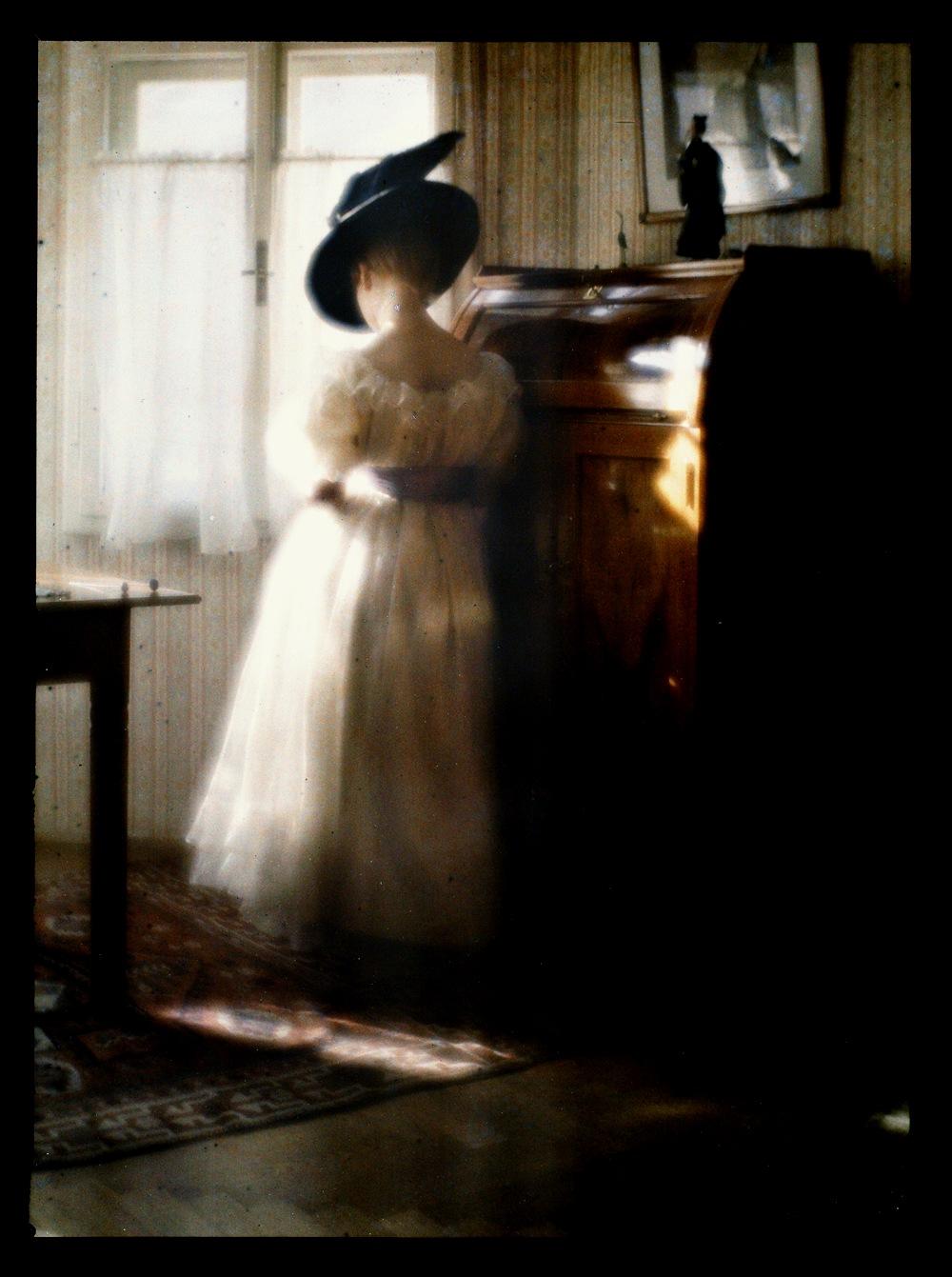 Lady in White Dress Leaning Against Desk.jpg-4.-2