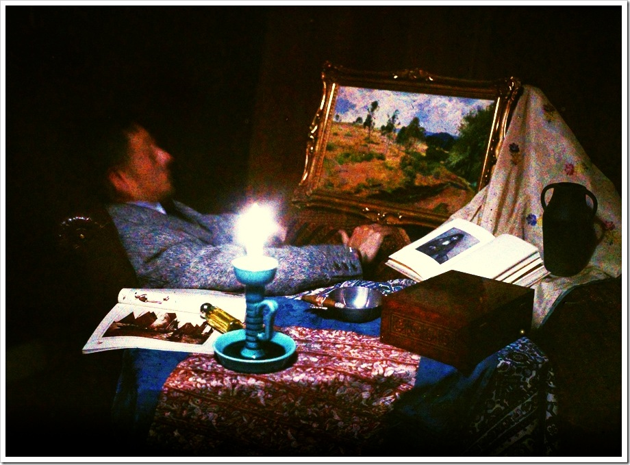 Ernest van Zuylen, E.v.Z. admiring a painting by candlelight - c.1917, autochrome 9 x 12