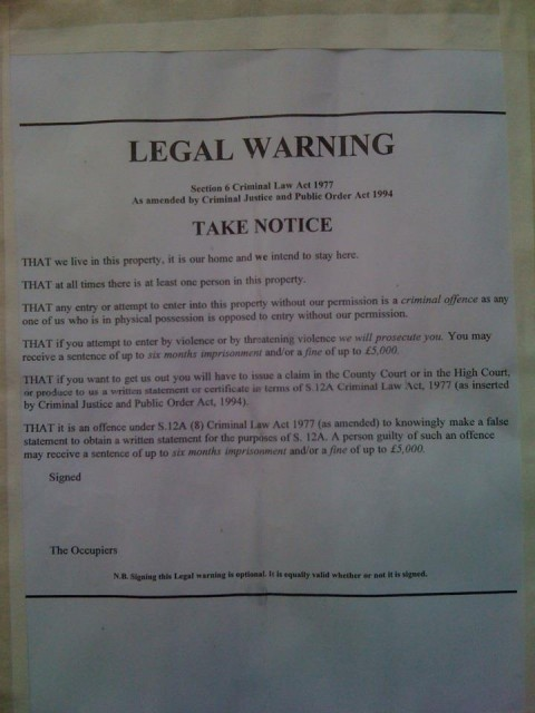 Notice posted by Occupy Belfast on the occupied Bank of Ireland building