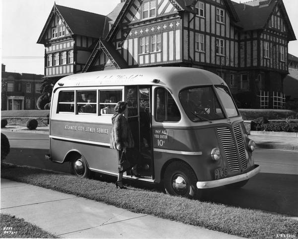 Woman wearing a mink coat boards an International Metro KB-3-M truck owned by Atlantic City Jitney Service 1948