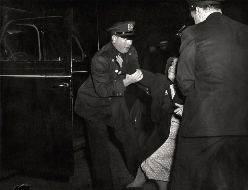 Weegee - The dead man's wife arrived, and she collapsed, ca. 1940