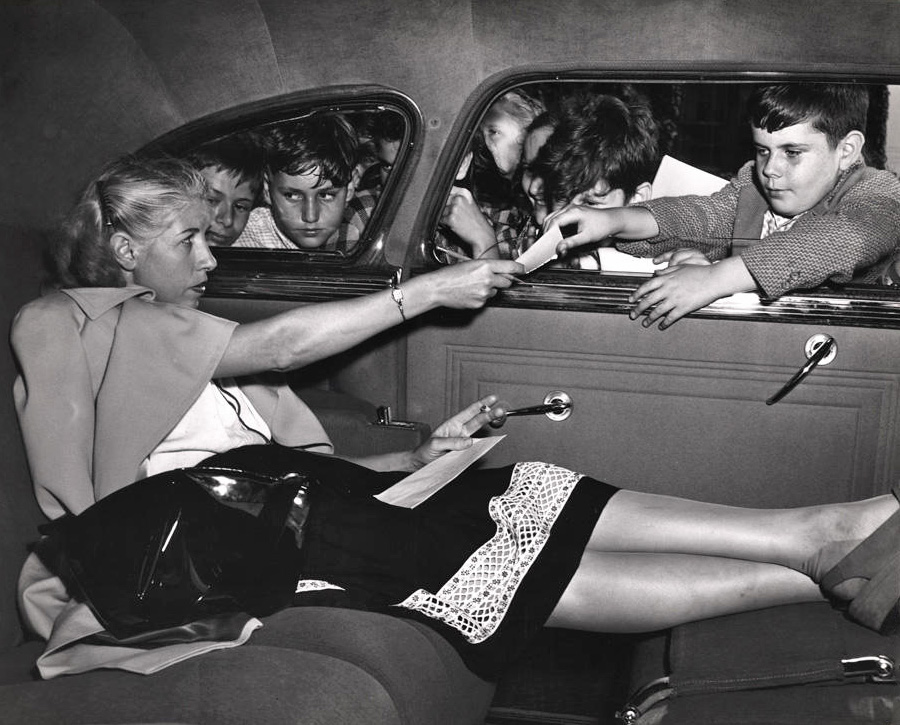 Weegee - Woman signing autographs