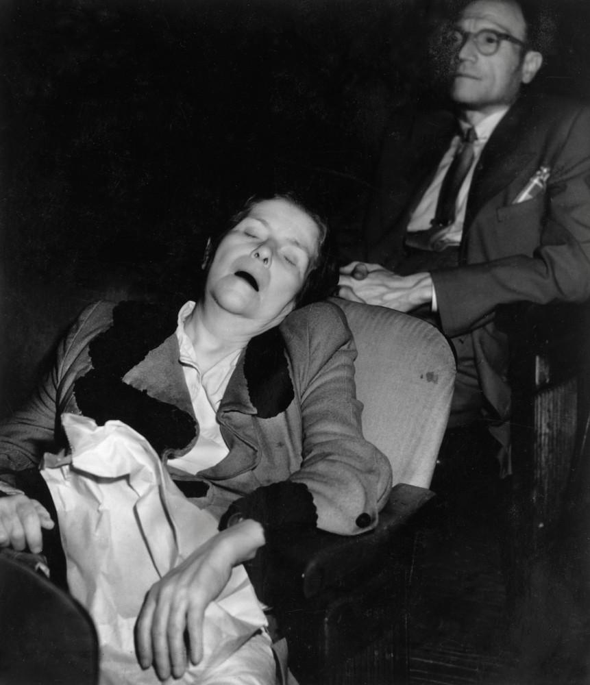 Weegee - Woman sleeping in movie theater, ca. 1943