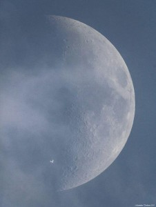 ISS against full moon by day