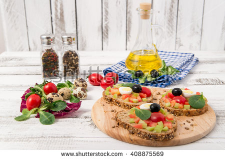stock-photo-bruschetta-with-tomato-olives-and-greenery-on-wooden-table-408875569