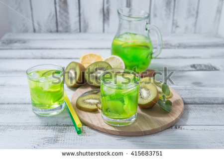 stock-photo-homemade-lemonade-with-kiwi-lemon-mint-in-glass-on-a-wooden-rustic-table-415683751