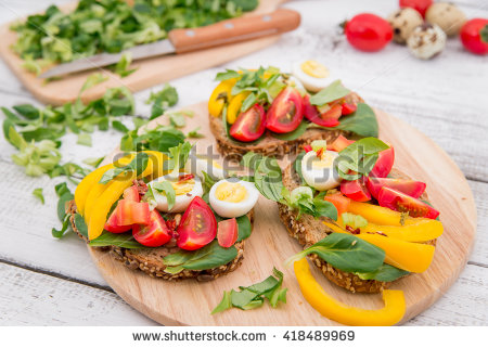 stock-photo-bruschetta-with-tomato-olives-and-greenery-on-wooden-table-418489969