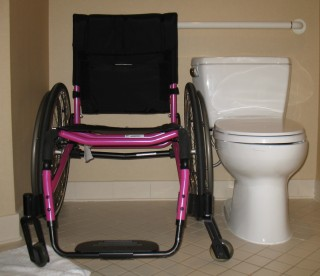 image of D's wheelchair next to a toilet